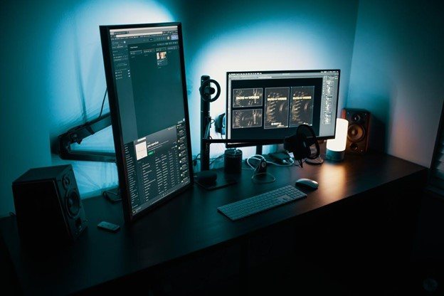 workplace workdesk with multi-monitor setup - via pexels